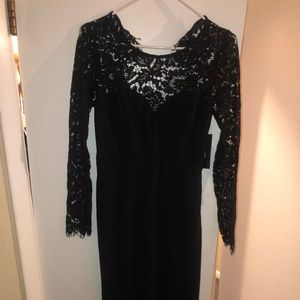 Black formal dress, never worn. Size medium.